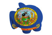 Piggy rich bank in colors flag of american state of idaho fo — Stock Photo
