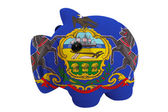 Piggy rich bank in colors flag of american state of pennsylvani — Stock Photo