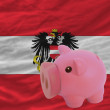 Piggy rich bank and national flag of austria — Stock Photo