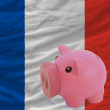 Royalty-Free Stock Photo: Piggy rich bank and  national flag of france