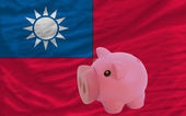 Piggy rich bank and national flag of taiwan — Stock Photo
