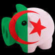 Piggy rich bank in colors national flag of algeria   for saving — Stock Photo