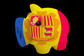 Piggy rich bank in colors national flag of andorra for saving — Stock Photo