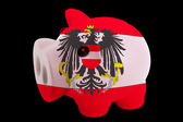 Piggy rich bank in colors national flag of austria for saving — Stock Photo