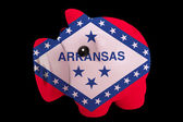 Piggy rich bank in colors flag of american state of arkansas f — Stock Photo