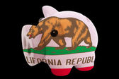 Piggy rich bank in colors flag of american state of california — Stock Photo