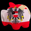 Bankrupt piggy rich bank in colors of national flag of austria   — Stock Photo