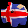 Bankrupt piggy rich bank in colors of national flag of iceland — Stock Photo