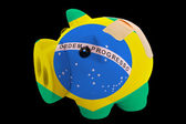 Bankrupt piggy rich bank in colors of national flag of brazil — Stock Photo