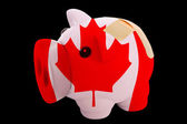 Bankrupt piggy rich bank in colors of national flag of canada — Stock Photo