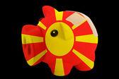 Fallimento banca ricco salvadanaio nei colori della bandiera nazionale della macedonia — Foto Stock