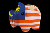 Bankrupt piggy rich bank in colors of national flag of malaysia — Stock Photo