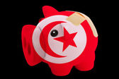 Bankrupt piggy rich bank in colors of national flag of tunisia — Stock Photo