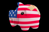Bankrupt piggy rich bank in colors of national flag of america — Stock Photo