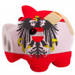 Closed piggy rich bank with bandage in colors national flag of a — Stock Photo