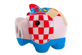 Closed piggy rich bank with bandage in colors national flag of c — Stock Photo