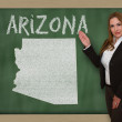 Teacher showing map of arizona on blackboard — Stock Photo