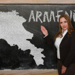 Teacher showing map of armenia on blackboard — Stock Photo