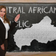 Teacher showing map of central african republic on blackboard — Stock Photo