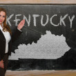 Teacher showing map of kentucky on blackboard — Stok fotoğraf