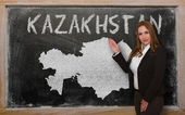 Teacher showing map of kazakhstan on blackboard — Stock Photo