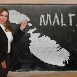 Teacher showing map of malta on blackboard — Stock Photo #25361323