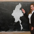 Royalty-Free Stock Photo: Teacher showing map of myanmar on blackboard