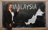 Carte d'affichage enseignant de malaisie sur tableau noir — Photo