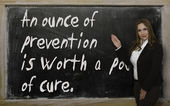 Teacher showing An ounce of prevention is worth a pound of cure2 — 图库照片