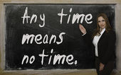 Teacher showing Any time means no time on blackboard — Stok fotoğraf