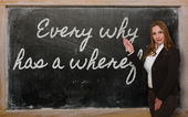 Teacher showing Every why has a wherefore on blackboard — 图库照片