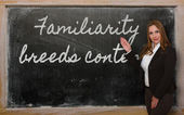 Teacher showing Familiarity breeds contempt on blackboard — Stock Photo