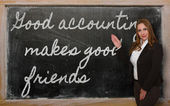Teacher showing Good accounting makes good friends on blackboar — Stockfoto