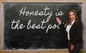 Teacher showing Honesty is the best policy on blackboard — Foto de Stock
