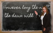 Teacher showing However long the night, the dawn will break on — Stock Photo