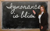 Teacher showing Ignorance is bliss on blackboard — Stockfoto