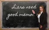 Teacher showing Liars need good memories on blackboard — Stock Photo