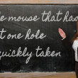 Teacher showing mouse that has but one hole is quickly taken — Stock Photo #25848433