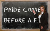 Teacher showing Pride comes before a fall on blackboard — Photo
