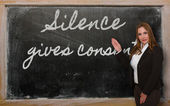 Teacher showing Silence gives consent on blackboard — Stock Photo