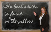Teacher showing The best advice is found on the pillow on blackb — Zdjęcie stockowe
