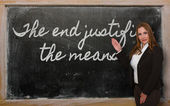 Teacher showing The end justifies the means on blackboard — Stock Photo