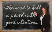 Teacher showing The road to hell is paved with good intentions o — Stok fotoğraf
