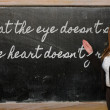 Teacher showing What eye doesn t see, heart doesn t grie — Stock Photo #25851545