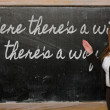 Teacher showing Where there s a will, there s a way on blackboar — Stockfoto