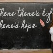 Teacher showing Where there s life there s hope on blackboard — 图库照片