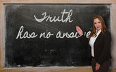 Teacher showing Truth has no answer on blackboard — Stok fotoğraf
