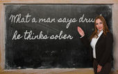 Teacher showing What a man says drunk, he thinks sober on blackb — ストック写真