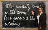 Teacher showing When poverty come in the door, love goes out the — Photo