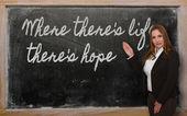 Teacher showing Where there s life there s hope on blackboard — Photo